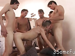 Cute young boy milks several cocks in a gay orgy