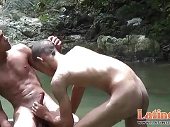 Spicy ethnic twinks give head in the shallow river