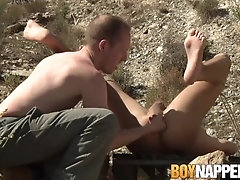 Restrained submissive gets a hard ass fingering outdoors